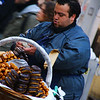 "An animated street vendor sells churros and donuts around the San Telmo barrio - Buenos Aires, Argentina.  This is a travel photo from Buenos Aires, Argentina. <a href=""http://nomadicsamuel.com"">http://nomadicsamuel.com</a>"