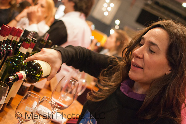 Photo of woman pouring wine
