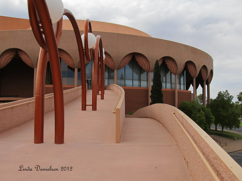 Grady Gammage Memorial Auditorium is considered to be the last public commission of architect Frank Lloyd Wright. Construction began on May 23, 1962; it took 25 months to complete.  <br /> Fifty concrete columns support the round roof with its pattern of interlocking circles; it seats 3,011people on three levels. The building was placed on the National Register of Historic Places in 1985.