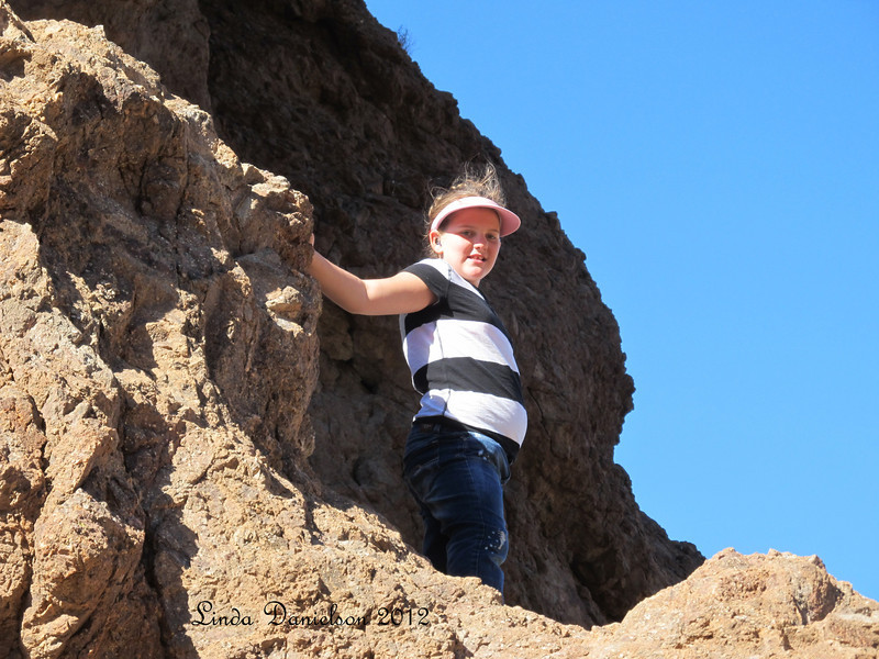 Bree climbing the rocks at Superstition Mountain