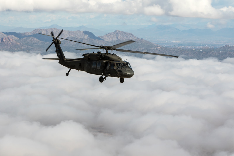 Black Hawk soars over clouds