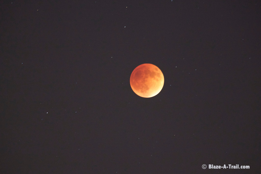 A lunar eclipse resulting in a Blood Moon rises in the east - view from Phoenix, Arizona (9/28/15)