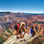 People on  hiking trip. Family on top of  mountain enjoying time together, looking at beautiful view. Inspiration Point, Bryce Canyon National Park, Utah, USA