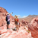 People on hiking trip. Father with his family taking pictures with phone, vacation in Red Rock Canyon Conservation Area, Nevada, USA.