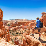 Man hiking in the mountains. Beautiful red mountain landscape.  Bryce Canyon National Park, Utah, USA