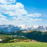 Beautiful Colorado spring landscape with green meadows and snow covered mountains. View from Trail Ridge Road. Rocky Mountains National Park. Close to Estates Park,Colorado ,USA.