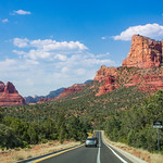 Scenic highway to beautiful red mountains in Sedona. Arizona,USA. Blue sky with clouds in the background. Copy space.
