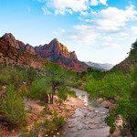 Beautiful red mountain landscape .Virgin River,  Watchman peak in the background, Zion National Park , UTAH, USA.