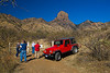 Baboquivari Peak is a sacred spire to the Tohono O'odham indians.  It is considered the center of the world and that I'itoli, the creator, continues to reside here. A geological dike can be seen running across the smaller peak to the right.  Not to worry, we weren't all riding in that red jeep.
