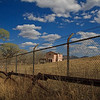 A Mexican house as seen through the border fence at Lochiel, Arizona.