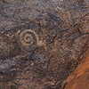 This spiral petroglyph is at the site of several metates ground into rock outcrops adjacent to a wash.  It is a clockwise spiral like at least one spiral petroglyph in Suguaro National Park, Tucson, Arizona.  It could be of Hohokum origen.