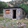 This stone cabin is in Soldier Basin, a very remote location in the Patagonia Mountains.  The dark stone above the doorway displays the date 1937.