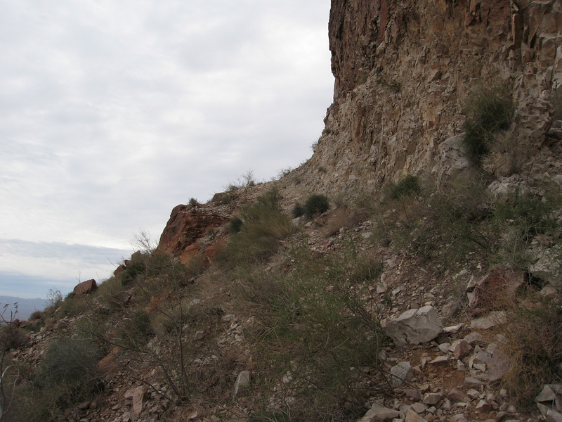 The route traverses along the cliff base.