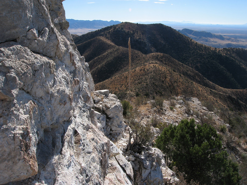 Looking back to the ridgeline from the cliff band. The path to this point is the narrow ledge in the immediate foreground.