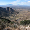 Looking back southwest into Hughes Canyon.  Apache Peak and Mt. Wrightson are in the distance.