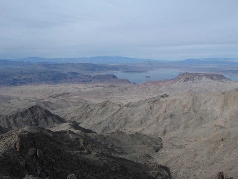 Looking west to Lake Mead with Las Vegas and Charleston Peak in the background.  The flat-topped Fortification Hill is on the right.