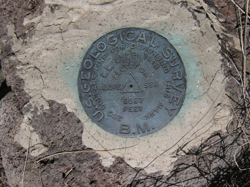 "Benchmark ""C.E. Uncertain 1958"""