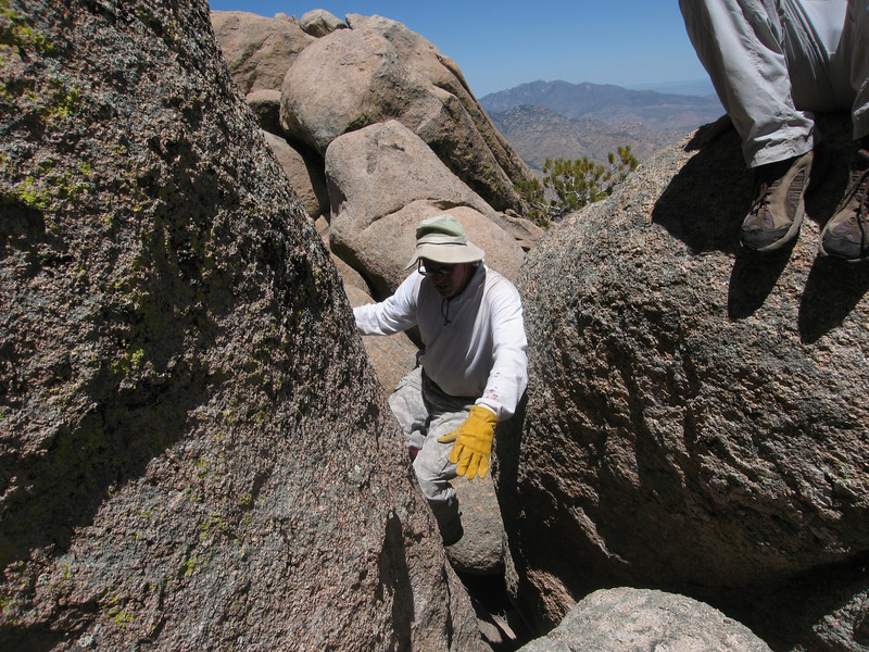 After topping out on the ramp, cross over to the other side and begin squirming between boulders like Rick.