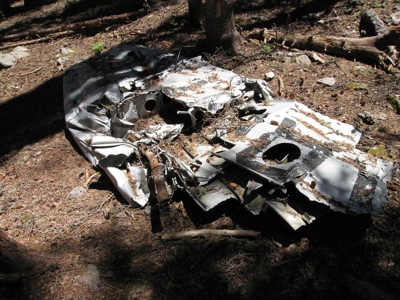 Debris from a 1950 plane crash lies along the trail.