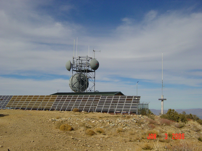 Large solar panel and microwave tower on the summit.