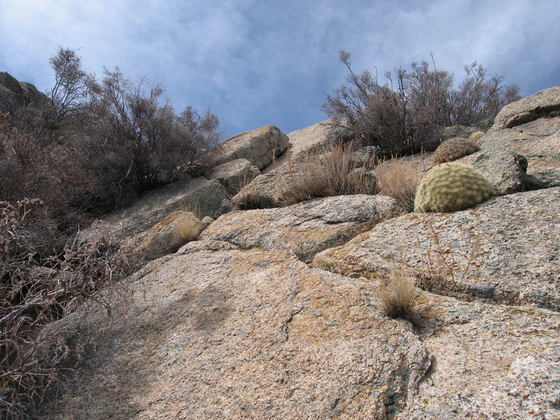 The tilted rock slab that leads to a ridge point just north of the summit.