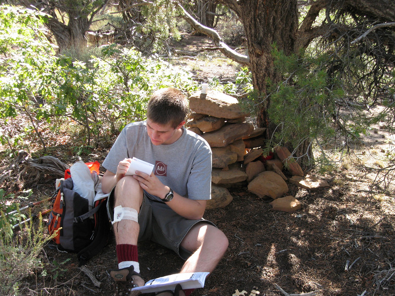 Chris signs the register with his 2nd Arizona county highpoint.  Note the right leg damage.