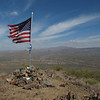 A flag, cairn and register tops the northern peak.