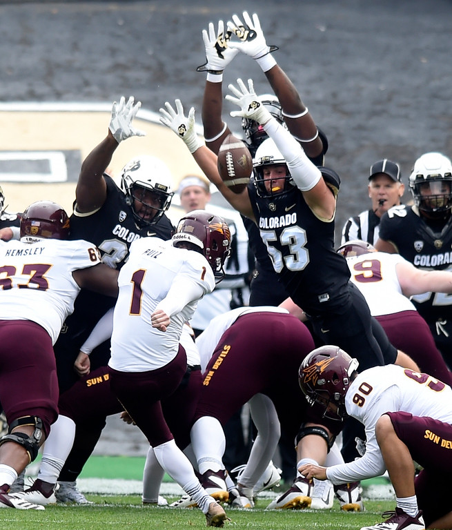 . BOULDER, CO: October 6, 2018: University of Colorado\'s   Nate Landman among others tries to block an extra point by ASU\'s Brandon Ruiz during  the game with Arizona State on October 6, 2018. (Photo by Cliff Grassmick/Staff Photographer)