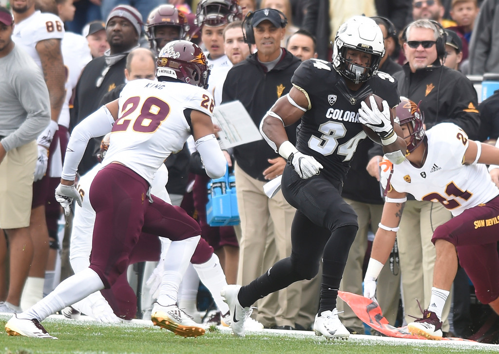 . BOULDER, CO: October 6, 2018: University of Colorado\'s   Travon McMillian gets past ASU\'s Daniel Talley during  the game with Arizona State on October 6, 2018. (Photo by Cliff Grassmick/Staff Photographer)