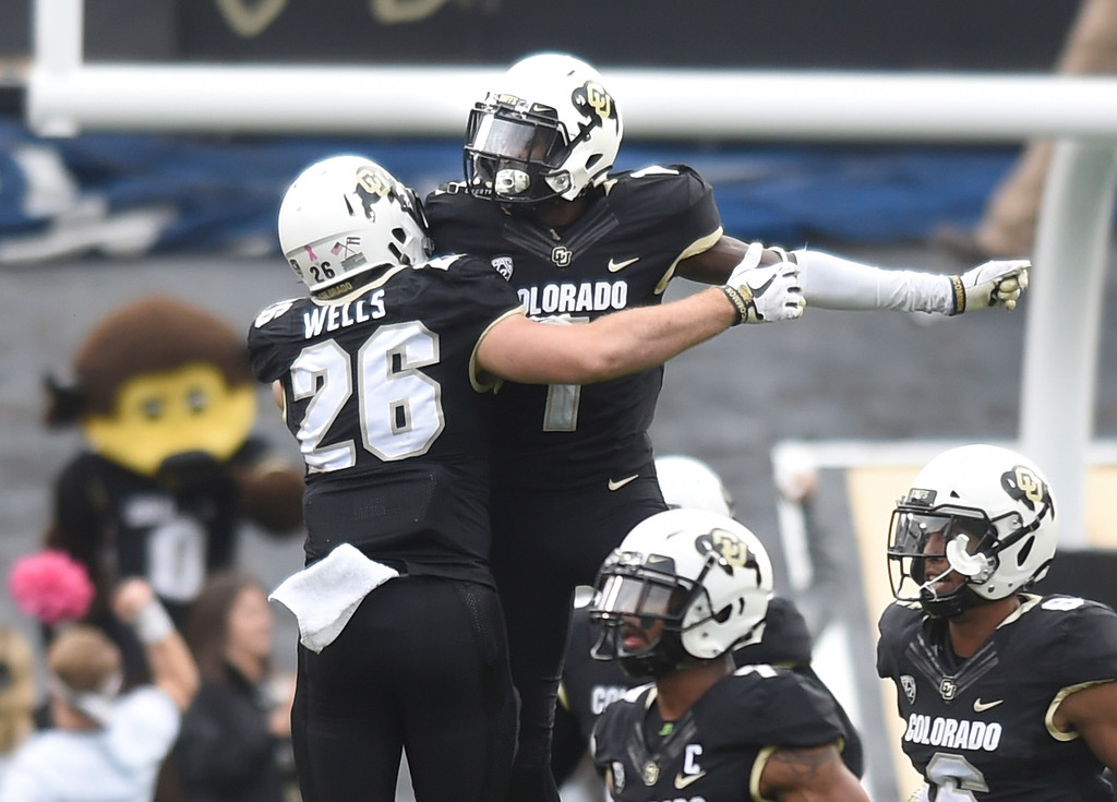 . BOULDER, CO: October 6, 2018: University of Colorado\'s Carson Wells, left, and Delrick Abrams, celebrate the defensive play by Abrams  during  the game with Arizona State on October 6, 2018. (Photo by Cliff Grassmick/Staff Photographer)
