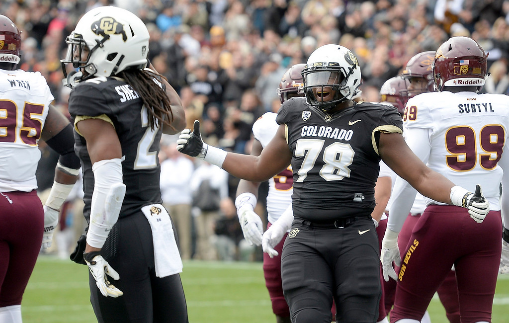 . BOULDER, CO: October 6, 2018: University of Colorado\'s  Laviska Shenault, left, scores a touchdown as William Sherman celebrates  during  the game with Arizona State on October 6, 2018. (Photo by Cliff Grassmick/Staff Photographer)