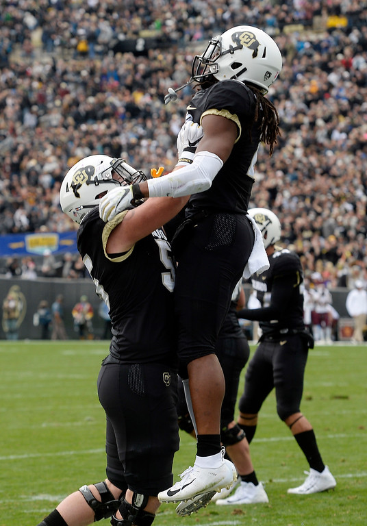 . BOULDER, CO: October 6, 2018: University of Colorado\'s   Laviska Shenault is picked up by Brett Tonz after his first touchdown during  the game with Arizona State on October 6, 2018. (Photo by Cliff Grassmick/Staff Photographer)