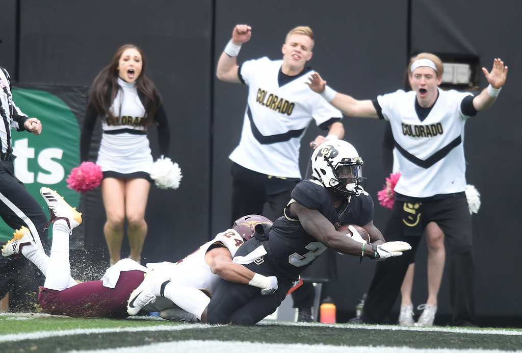 . BOULDER, CO: October 6, 2018: University of Colorado\'s KD Nixon makes a long catch past ASU\'s Chase Lucas down to the one yard line  during  the game with Arizona State on October 6, 2018. (Photo by Cliff Grassmick/Staff Photographer)