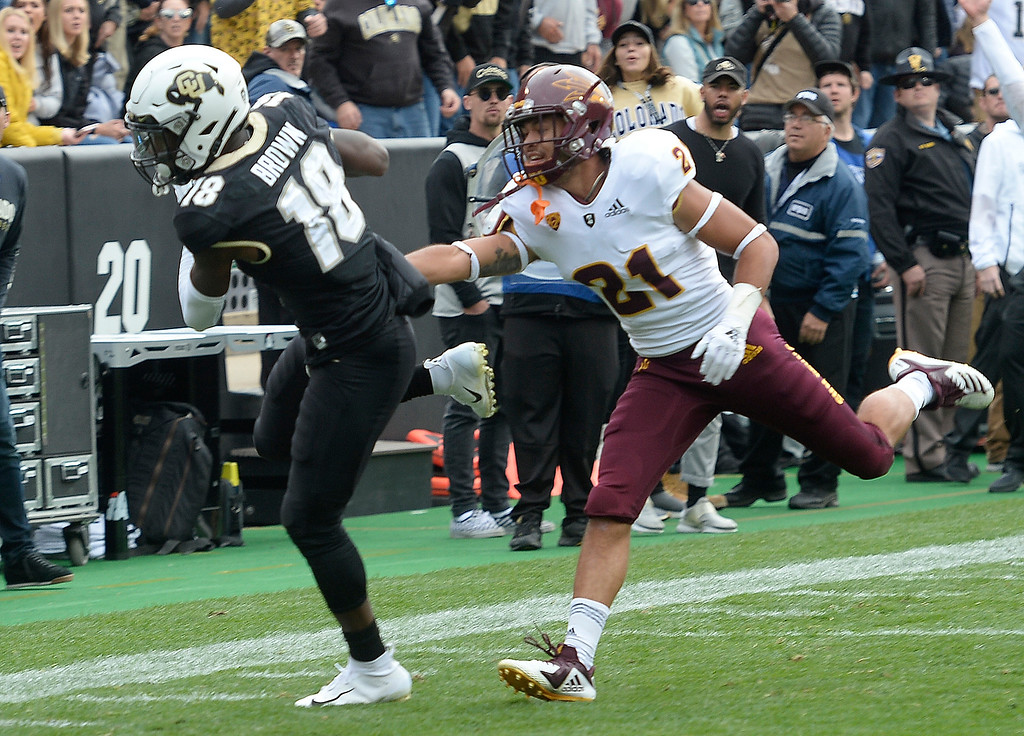 . BOULDER, CO: October 6, 2018: University of Colorado\'s Tony Brown catches a pass over ASU\'s Terin Adams    during  the game with Arizona State on October 6, 2018. (Photo by Cliff Grassmick/Staff Photographer)