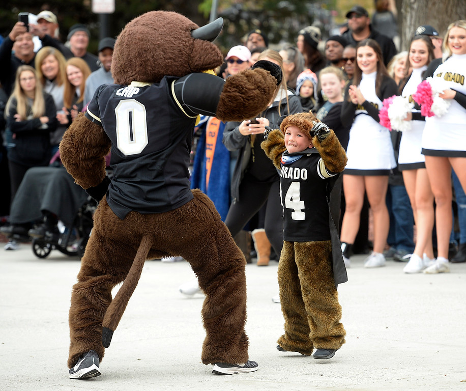 . BOULDER, CO: October 6, 2018:  Rory Benham, 7, dances with Chip before the game with Arizona State on October 6, 2018. (Photo by Cliff Grassmick/Staff Photographer)