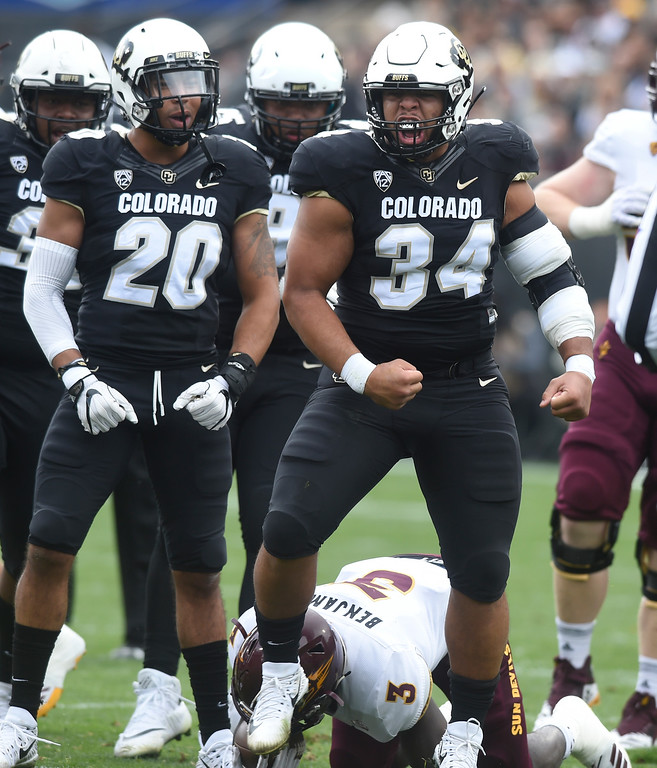. BOULDER, CO: October 6, 2018: University of Colorado\'s  Mustafa Johnson celebrates a tackle for a loss of ASU\'s Eno Benjamin  during  the game with Arizona State on October 6, 2018. (Photo by Cliff Grassmick/Staff Photographer)