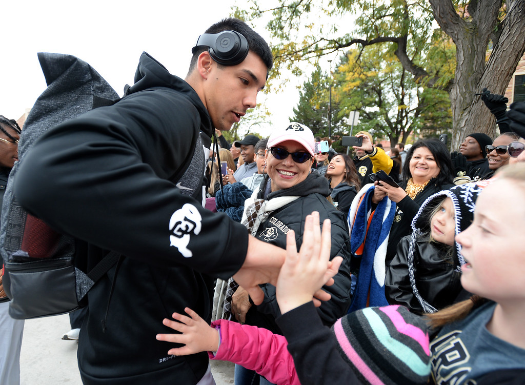. BOULDER, CO: October 6, 2018: Steven Montez says hello to his family along the Buff Walk  before the game with Arizona State on October 6, 2018. (Photo by Cliff Grassmick/Staff Photographer)