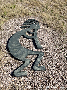 Large cast Kokopelli near a bike trail in Prescott