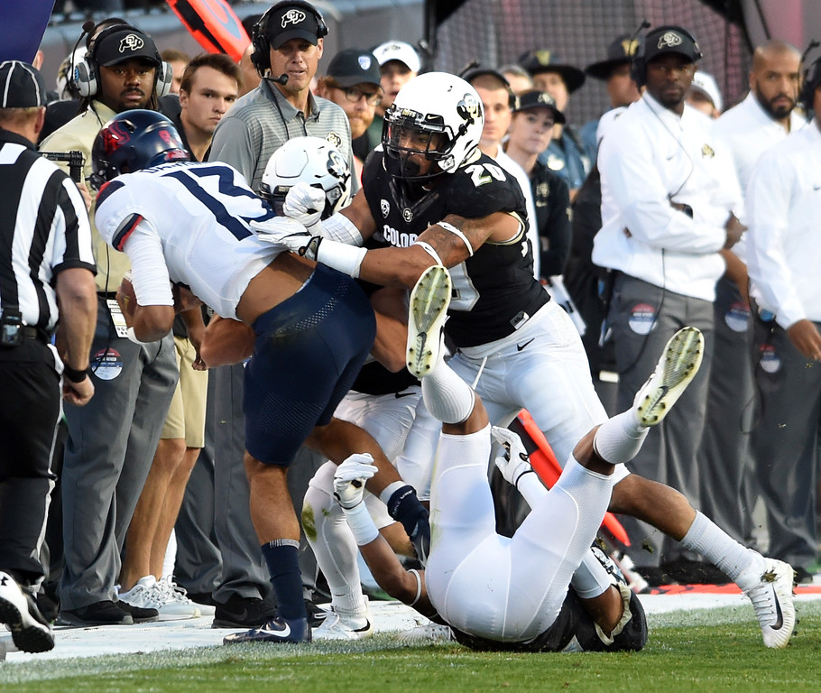 . Arizona QB, Brandon Dawkins is knocked out of the game by Drew Lewis, of CU, during the CU game with Arizona.  Cliff Grassmick / Staff Photographer/ October 7, 2017