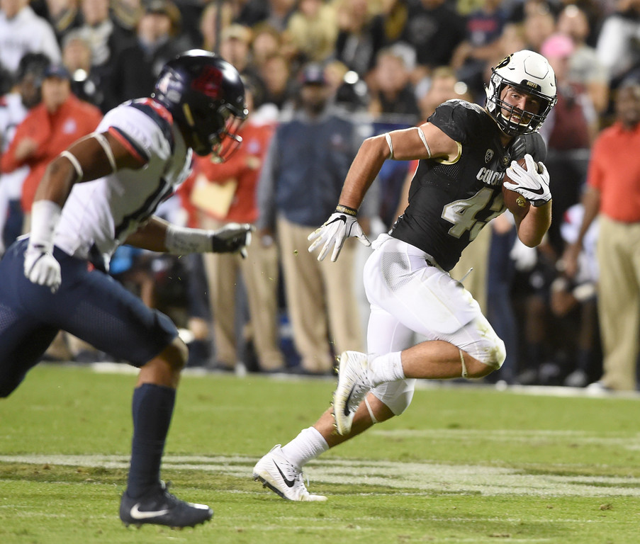 . Chris Bounds, of CU, scores on his second TD catch during the CU game with Arizona.  Cliff Grassmick / Staff Photographer/ October 7, 2017