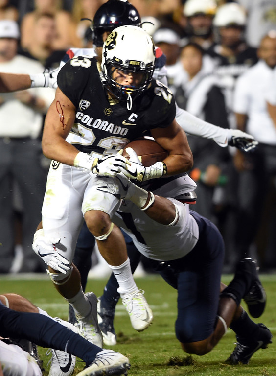 . Phillip Lindsay, of CU, runs hard in the red zone during the CU game with Arizona.  Cliff Grassmick / Staff Photographer/ October 7, 2017
