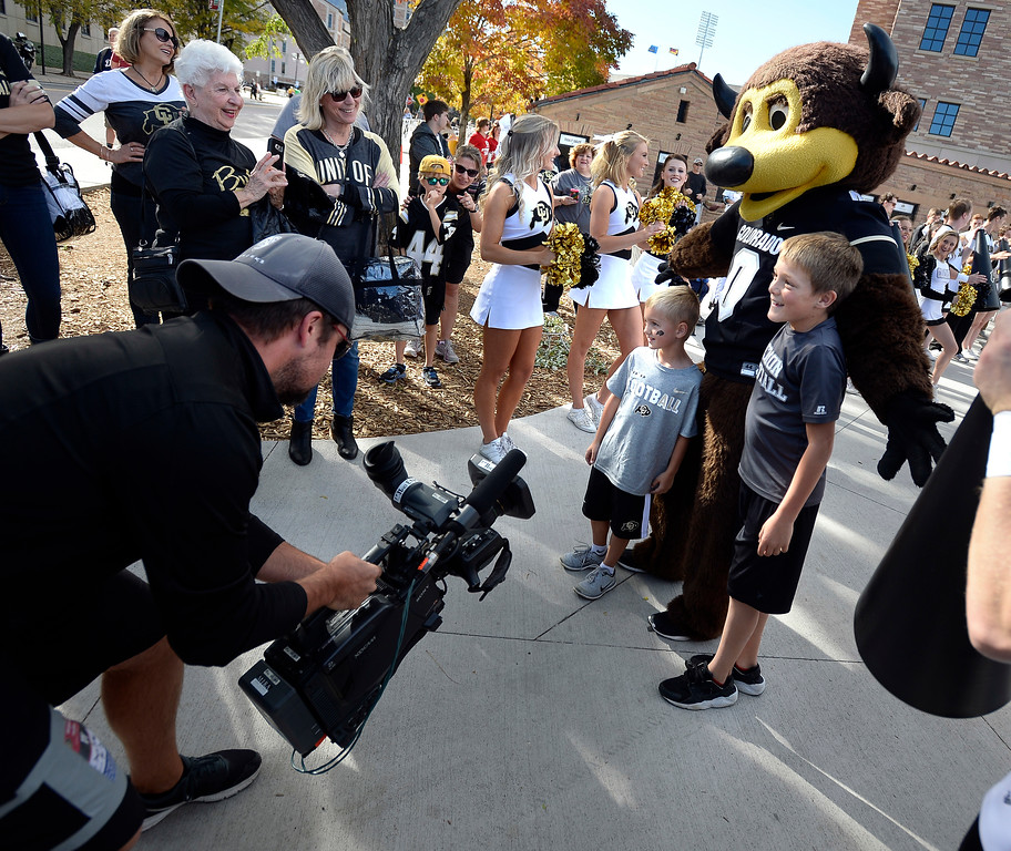 . Chip finds some new fan to get photos with before the CU game with Arizona.  Cliff Grassmick / Staff Photographer/ October 7, 2017