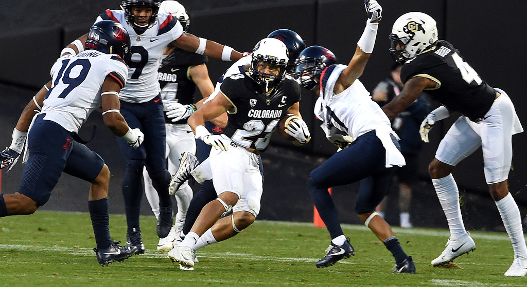 . Phillip Lindsay, of CU, tries to escape during the CU game with Arizona.  Cliff Grassmick / Staff Photographer/ October 7, 2017