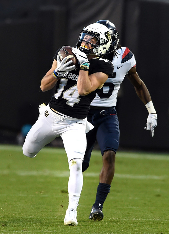 . Jay MacIntyre, of CU, makes the catch during the CU game with Arizona.  Cliff Grassmick / Staff Photographer/ October 7, 2017