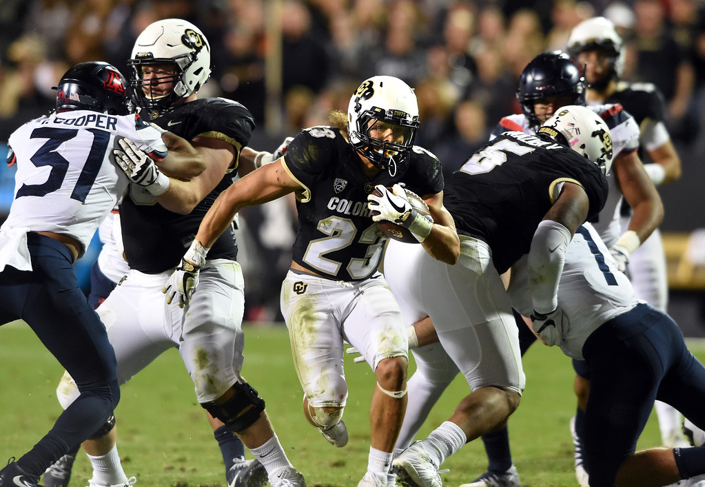 . Phillip Lindsay, of CU, takes off on a record breaking night during the CU game with Arizona.  Cliff Grassmick / Staff Photographer/ October 7, 2017