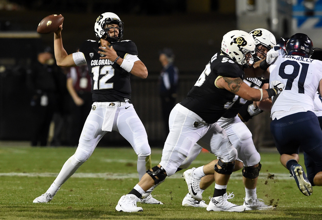 . Steven Montez, of CU, throws down field during the CU game with Arizona.  Cliff Grassmick / Staff Photographer/ October 7, 2017