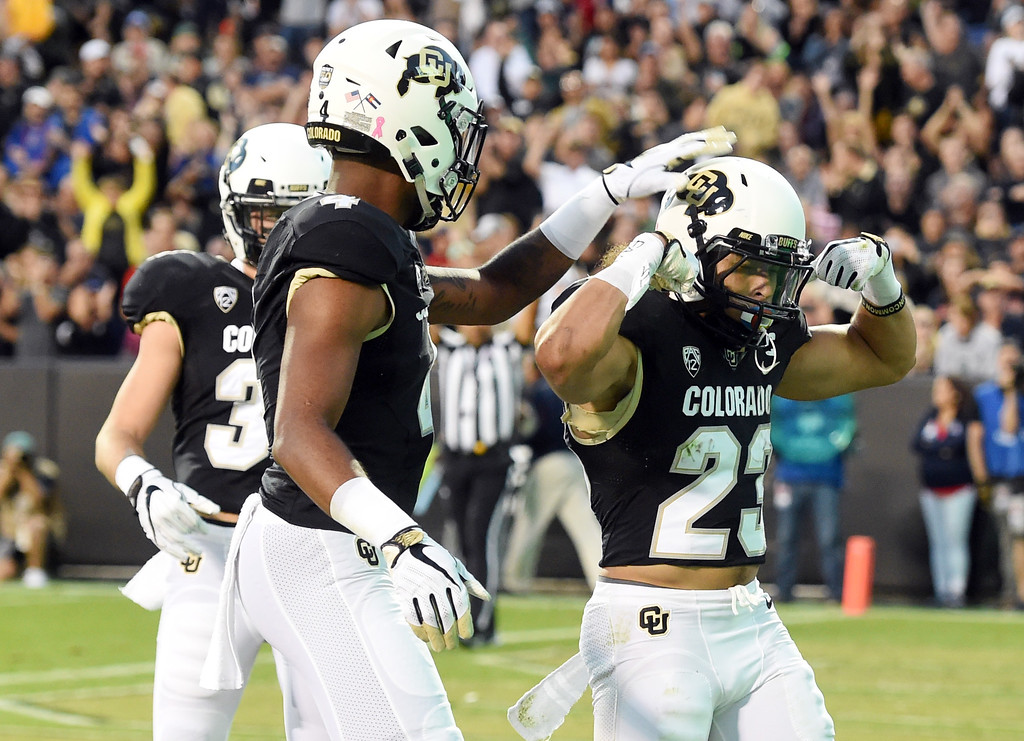 . Phillip Lindsay, of CU, celebrates his TD run with teammates during the CU game with Arizona.  Cliff Grassmick / Staff Photographer/ October 7, 2017