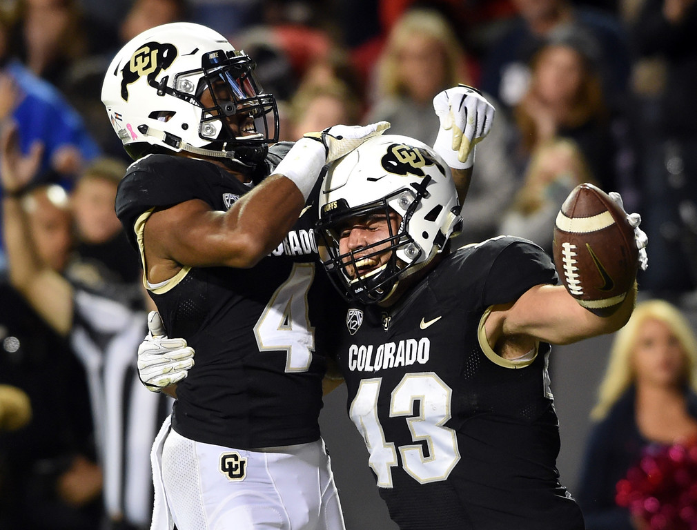 . Chris Bounds, of CU, celebrates his TD catch with Bryce Bobo during the CU game with Arizona.  Cliff Grassmick / Staff Photographer/ October 7, 2017