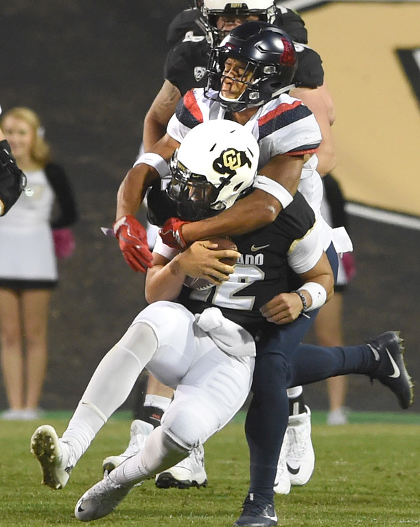 . CU QB, Steven Montez, is sacked by the Arizona defender during the CU game with Arizona.  Cliff Grassmick / Staff Photographer/ October 7, 2017