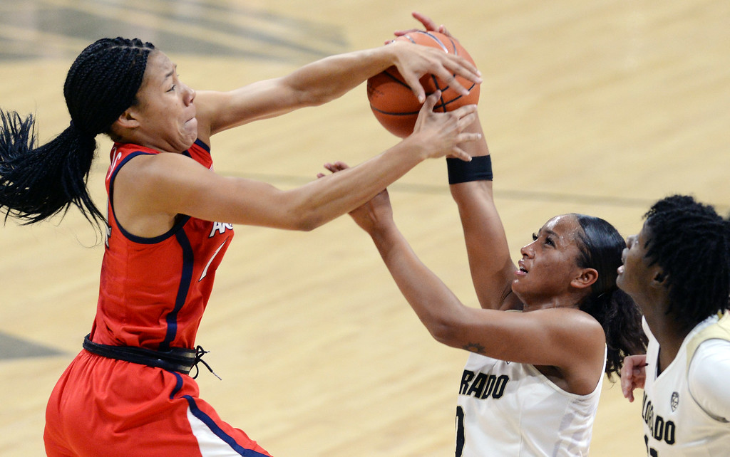 . BOULDER, CO: January 4, 2019: Sam Thomas, of Arizona , blocks the shot of Quinessa Caylao-Do, of CU, during the game with Arizona on Friday night. For more photos, go to dailycamera.com. (Photo by Cliff Grassmick/Staff Photographer)
